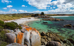 Bay of Fires, Tasmania. The Bay of Fires on Tasmania's northeast coast is famous for fantastic weather, bright orange rocks (caused by a crustose lichen), and Stock Image