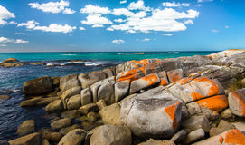 Bay of Fires, Tasmania. The Bay of Fires on Tasmania's northeast coast is famous for great weather and vibrant colors. The ocean is a brilliant aqua green and Stock Images
