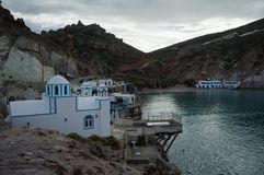 Bay of Firopotamos with Traditional Greek Fishermen Houses and C royalty free stock image
