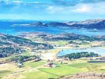 Bay with village and seascape view from island mountain. Bay with fishing village and seascape view from island mountain. Rain is close. Aerial view to bay with royalty free stock photography