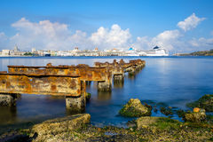 The Bay of Havana and the Old Havana skyline with a rusty iron pier on the foreground Stock Image