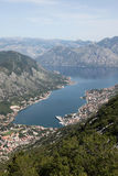 Bay of Kotor with high mountains plunge into Adriatic sea and Historic town of Kotor, Montenegro Stock Photo