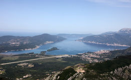 Bay of Kotor with high mountains plunge into adriatic sea and town of Tivat, Montenegro Stock Photography