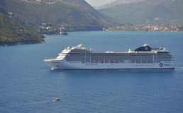 Cruise ship MSC Musica. BAY OF KOTOR, MONTENEGRO – SEPTEMBER 16, 2017: Cruise ship MSC Musica floats from the Kotor Bay stock photography