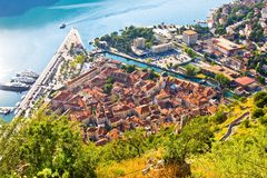 Bay of Kotor in Montenegro with view of mountains, boats and old houses with red tile roofs Stock Photography