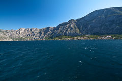 Bay of Kotor, settlement at the foot of mountain. Montenegro Stock Photo