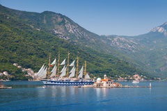 Bay of Kotor. Small island and sailing ship Royalty Free Stock Photos
