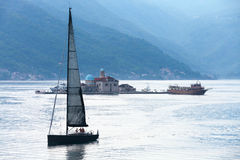 Bay of Kotor. Small island and yacht Royalty Free Stock Photo
