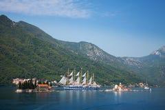 Bay of Kotor. Small islands and sailing ship Royalty Free Stock Photography