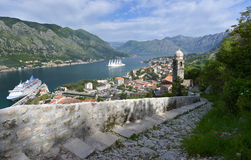 The Bay of Kotor. View of the Bay of Kotor and Kotor city from the wall of fortress, stairway and bell tower of the church Stock Image