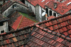 The Bay of Kotor is a wonderful natural Bay in Montenegro. The shingles on the roofs of the Old town on the Bay of Kotor in Montenegro Stock Image