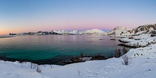 Bay on Kvaloya island after sundown, Norway. Colorful bay panonama in winter after sundown on Kvaloya island, polar region of Norway. Scenery near Sommaroy Stock Image