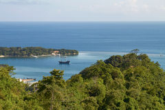 Bay and laguna with a boat in Roatan in Honduras. Stock Photography