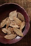 Bay leaf, dried herb in a bowl. Bay leaf, dried herb in a ceramic bowl, top view Stock Photo