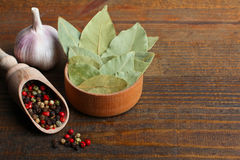 Bay leaf, garlic  and a mixture of peppers Stock Photography