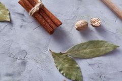 Bay leaf, nutmeg and spices on white textured background, top view, close-up, selective focus. Scented condiment. Aromatic spices. Exotic ingredient. Indian Stock Photo