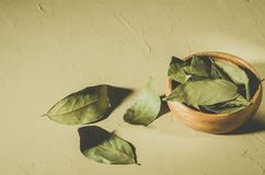 Bay leaf in a wooden bowl/spices of bay leaf in rural style on a light background stock photo