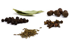 Bay leafs, cloves, caraway and black pepper Royalty Free Stock Images