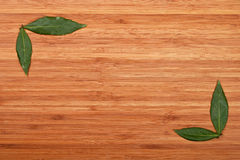 Bay leaves frame corners over bamboo wood Royalty Free Stock Photos