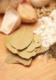 Bay leaves, garlic and food ingredients Stock Image