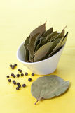 Bay leaves and peppercorns Royalty Free Stock Photography