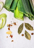 Bay leaves and spices on white wooden background stock photo