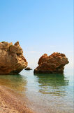 Bay in mediterranean sea and tall cliffs. Royalty Free Stock Photo