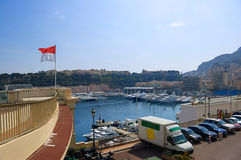 Bay in Monaco. With yachts, cars and flag Royalty Free Stock Images