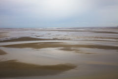 Bay of Mont St. Michel. At low tide Stock Photos