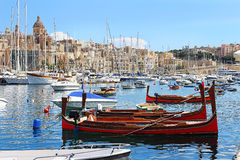 In the bay moored many yachts, boats, ship and sub. Malta port Birgu with its colourful boats features. In the foreground are moored gondolas. In the bay moored Royalty Free Stock Photography