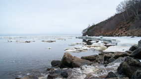 The Bay of Nagaev / Spring. During the Gulag era the bay was used as a transit point for Gulag inmates coming by sea and further directed to camps of Magadan and Stock Photo