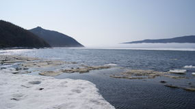 The Bay of Nagaev / Spring. During the Gulag era the bay was used as a transit point for Gulag inmates coming by sea and further directed to camps of Magadan and Stock Images