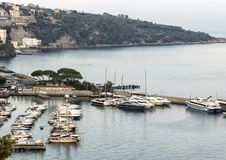 Bay of Naples Marina Grande and adjacent boats, Sorrento. Pictured is the Bay of Naples with a boat dock area and Marina Grande, a fishing village, in the stock images