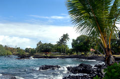Bay near Hilo, Hawaii. Bay view near Hilo, Hawaii.  Small memorial park flies flag of Japan and the United States.  Palm fronds frame right side of photo Royalty Free Stock Photos