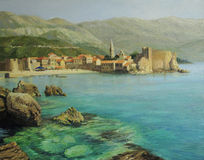 Bay near Old Budva. An oil painting on canvas of the bay near old town Budva on the Montenego riviera with the beach and the fortress city walls at the Royalty Free Stock Image