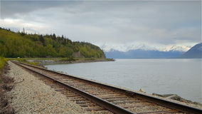 Bay near Railway, Cloudy day. Perspective of the rail at the bottom of the frame. Cloudy day, Anchorage, Alaska stock video footage