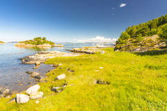 Bay on the Norwegian countryside, rural landscape. Kongensvoll Hitra, Norway - August 19, 2016:  Sunny day on the Norwegian fjord coast. Azure water on shallow Stock Image