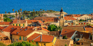 The bay and the old town of Menton on the French Riviera. Panoraminc view onto the old terracotta rooftops and the bay of the old town of Menton on the French royalty free stock photos