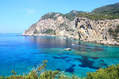 The bay of paleokastritsa. Turquoise blue waters of the sea and the cliffs of famous paleokastritsa bay in corfu Stock Photos