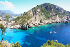 The bay of paleokastritsa. Turquoise blue waters of the sea and the cliffs of famous paleokastritsa bay in corfu Stock Photo