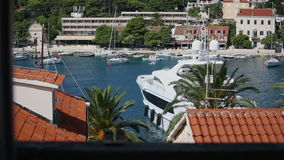 Bay with pleasure yachts in Croatia, Hvar island stock footage
