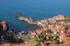Bay port and town on coast. Camara-de-Lobos, Madeira, Portugal Royalty Free Stock Images