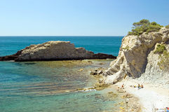 Bay with rocks. Grit beach in a Mediterranean Sea bay with rocks Royalty Free Stock Photos