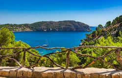 Bay with sailing boat and beautiful seaside scenery. Beautiful seaside view with boats at the coastline of Camp de Mar on Majorca Spain, Mediterranean Sea Royalty Free Stock Images