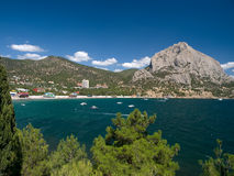 Bay of the sea with boats. View of bay with boats and resort against a mountains Stock Photo