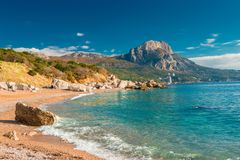 The bay of the sea with clear azure water and high mountains, sunny landscape, Crimea. Russia royalty free stock images