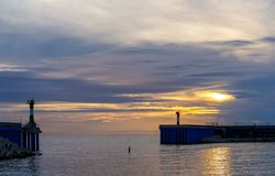 Bay at sunset. Bay at sea with lighthouses at sunset Royalty Free Stock Photography