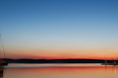 Bay Seascape at Dusk. Orange Bay Seascape at Dusk with Clear Blue Sky royalty free stock photo