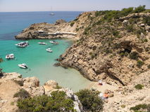Bay. A small beautiful sandy bay between cliffs in Ibiza at Cala Tarida beach Royalty Free Stock Photo