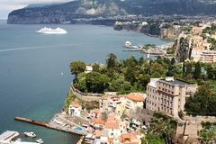 Bay  at Sorrento Italy. The small marina and large marina at Sorrento Italy showing boats water and buildings and cruise ship Stock Photo